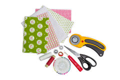 Composition of patchwork quilting instruments, items and fabrics Royalty Free Stock Photos