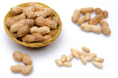 Composition with peanuts in a basket, opened and whole peanuts Stock Photo