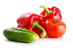 Composition with pepper tomato and cucumber. Composition with freshly washed vegetables isolated on white Royalty Free Stock Photo