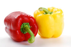 Composition with peppers. Freshly washed vegetables with visible drops of water isolated on white Royalty Free Stock Photography