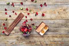 Composition with petals, incense and aroma candle on wooden board Stock Photography