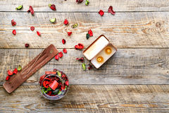 Composition with petals, incense and aroma candle on wooden board Stock Photo