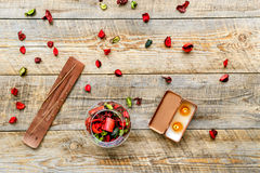 Composition with petals, incense and candle on a wooden board Stock Photo