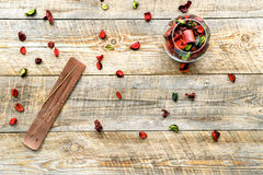 Composition with petals, incense and candle on a wooden board Stock Image