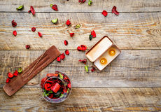 Composition with petals, incense and candle on wooden board Royalty Free Stock Photos