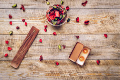 Composition with petals, incense and candle on wooden board Royalty Free Stock Image