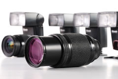 Composition with photo zoom lenses on white. Composition with photo zoom lenses and flashes isolated on white background Royalty Free Stock Photos