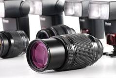 Composition with photo zoom lenses on white. Composition with photo zoom lenses and flashes isolated on white background Royalty Free Stock Photography