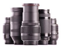 Composition with photo zoom lenses on white Royalty Free Stock Photo
