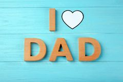 Composition with phrase I LOVE DAD. For Father's Day on wooden background Stock Photos