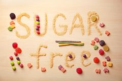Composition with phrase SUGAR FREE. On wooden background stock images