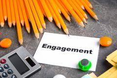 Composition with phrase `Time to Engage`. Written in notebook royalty free stock image