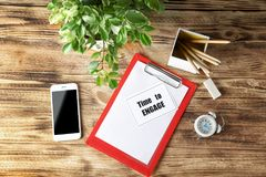 Composition with phrase `Time to Engage` written in notebook. On wooden background royalty free stock photography