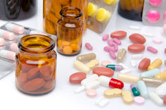Composition with pills, tablets and capsules. Isolated on white Royalty Free Stock Images