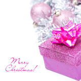 Composition with pink gift box and christmas balls, isolated Royalty Free Stock Photos