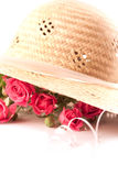 Composition with pink miniature roses and hat Royalty Free Stock Photography