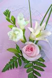 Composition of pink rose. And a lily Stock Photography