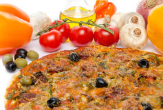 Composition with a pizza and some ingredients. Composition with a pizza, oil and fresh vegetables Royalty Free Stock Photography