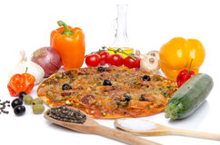 Composition with a pizza and some ingredients. On white Stock Photography