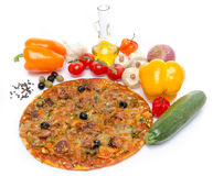 Composition with a pizza and some ingredients. On white Stock Photos