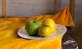 Composition of a plate filled with apples Stock Photos