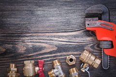 Composition of plumbers equipment on wooden board plumbing conce Royalty Free Stock Photography