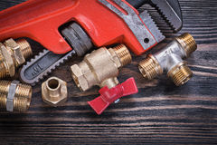 Composition of plumbing tools on wooden board horizontal version Stock Photos