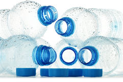 Composition with polycarbonate plastic bottles of mineral Royalty Free Stock Image