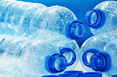 Composition with polycarbonate plastic bottles of mineral Royalty Free Stock Images