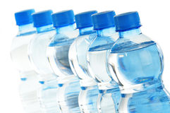 Composition with polycarbonate plastic bottles of mineral Stock Photo