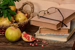 Composition of pomegranates and books Royalty Free Stock Images