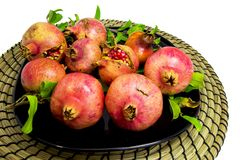 Composition of pomegrantes used as table masterpiece. For autumn, fall and home diy concepts Royalty Free Stock Images
