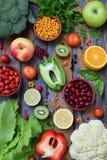 Composition of products containing ascorbic acid, vitamin C - citrus, cauliflower, broccoli, sweet pepper, kiwi, dog rose, tomatoe Royalty Free Stock Photo