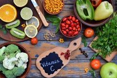 Composition of products containing ascorbic acid, vitamin C - citrus, cauliflower, broccoli, sweet pepper, kiwi, dog rose, tomatoe Stock Photography