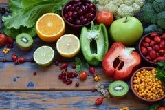 Composition of products containing ascorbic acid, vitamin C - citrus, cauliflower, broccoli, sweet pepper, kiwi, dog rose, tomatoe Stock Photos