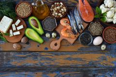 Composition of products containing unsaturated fatty acids Omega 3 - fish, nut, tofu, avocado, egg, soybean, flax, pumpkin seeds,. Composition of products Stock Photography