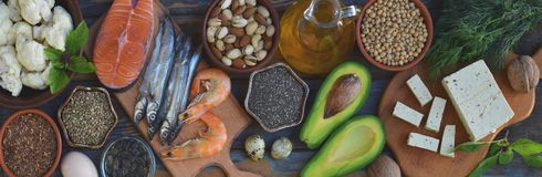 Composition of products containing unsaturated fatty acids Omega 3 - fish, nut, tofu, avocado, egg, soybean, flax, pumpkin seeds,. Composition of products Stock Photo
