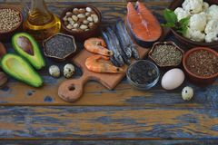 Composition of products containing unsaturated fatty acids Omega 3 - fish, nuts, avocado, eggs, soybeans, flax, pumpkin seeds, chi. A, hemp, cauliflower, dill Stock Photos
