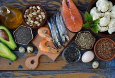 Composition of products containing unsaturated fatty acids Omega 3 - fish, nuts, avocado, eggs, soybeans, flax, pumpkin seeds, chi. A, hemp, cauliflower, dill Stock Images