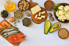 Composition of products containing unsaturated fatty acids Omega 3 - fish, nuts, tofu, avocado, egg, soybean, flax, pumpkin seeds, Royalty Free Stock Photo