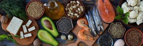 Composition of products containing unsaturated fatty acids Omega 3 - fish, nuts, tofu, avocado, egg, soybeans, flax, pumpkin seeds. Chia, hemp, cauliflower Royalty Free Stock Photo