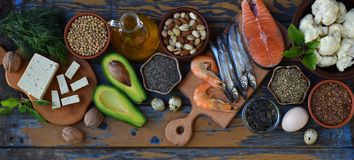 Composition of products containing unsaturated fatty acids Omega 3 - fish, nuts, tofu, avocado, egg, soybeans, flax, pumpkin seeds. Composition of products Royalty Free Stock Photography