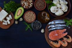 Composition of products containing unsaturated fatty acids Omega 3 - fish, nuts, tofu, avocado, eggs, soybeans, flax, pumpkin seed Royalty Free Stock Photo
