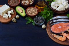Composition of products containing unsaturated fatty acids Omega 3 - fish, nuts, tofu, avocado, eggs, soybeans, flax, pumpkin seed. S, cauliflower, dill Stock Photos