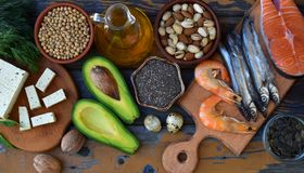 Composition of products containing unsaturated fatty acids Omega 3 - fish, nuts, tofu, avocado, eggs, soybeans, pumpkin seeds, chi. A, hemp, dill, vegetable oil Stock Photos