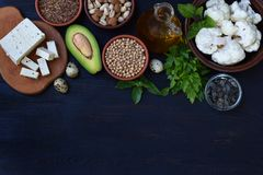 Composition of products containing unsaturated fatty acids Omega 3 - nuts, tofu, avocado, eggs, soybeans, flax, pumpkin seeds, cau. Liflower, dill, vegetable oil Royalty Free Stock Image