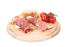 Composition of prosciutto on wooden platter. Stock Photography