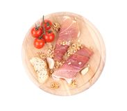 Composition of prosciutto on wooden platter. Royalty Free Stock Photography