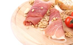 Composition of prosciutto on wooden platter. Royalty Free Stock Photos