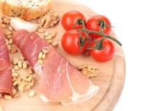 Composition of prosciutto on wooden platter. Royalty Free Stock Photo